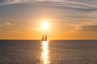 Boat with Two Sails at Sunset