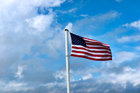 American Flag and Cloudy Sky